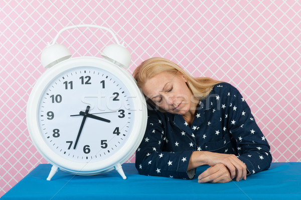 Stock photo: Woman with insomnia and big alarm clock