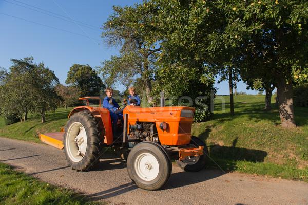 Farm Boys on tractor Stock photo © ivonnewierink