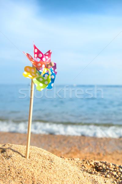 Játék szélturbina színes tengerpart műanyag Stock fotó © ivonnewierink