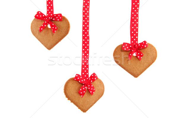 Baked hanging gingerbread hearts Stock photo © ivonnewierink