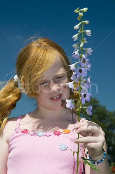 Girl with larkspur flower Stock photo © ivonnewierink
