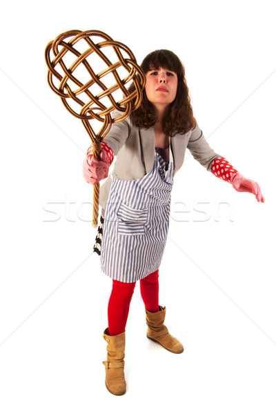 Housewife with carpet beater Stock photo © ivonnewierink