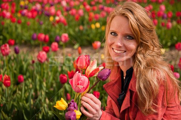 Dutch blond girl in field with tulips Stock photo © ivonnewierink