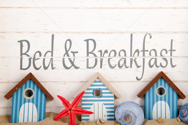 Bett Frühstück Küste blau Häuser weiß Stock foto © ivonnewierink