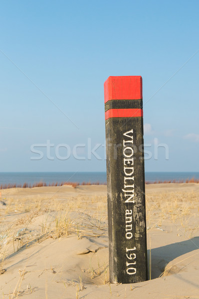 Stock photo: High tide pole at Texel