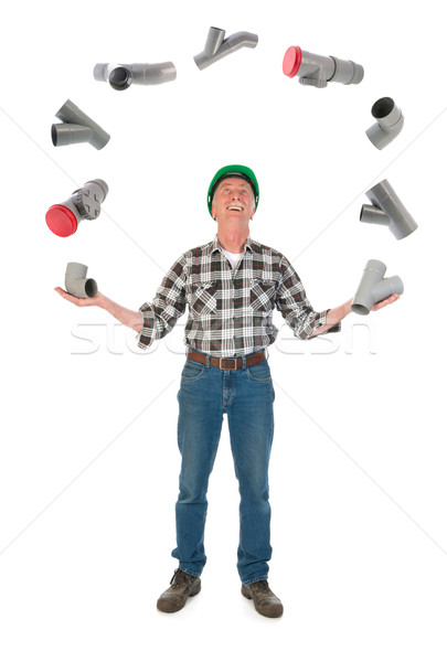 Juggling plumber with PVC tubes Stock photo © ivonnewierink