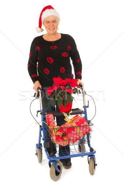 Senior woman going to Christmas celebration Stock photo © ivonnewierink