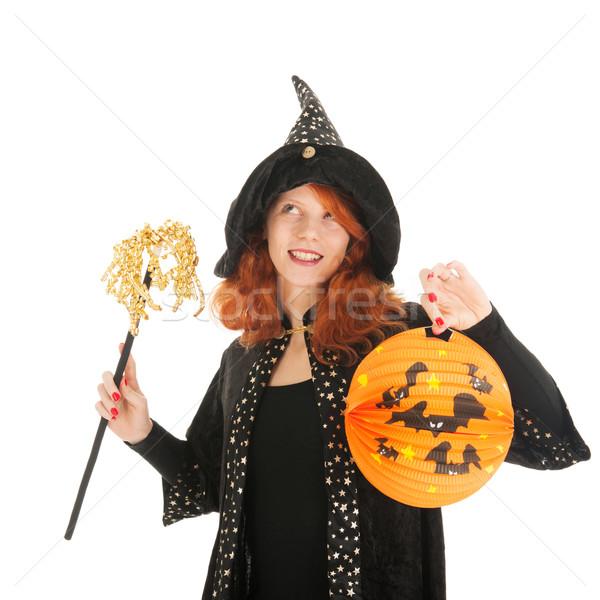 Gonosz boszorkány halloween fiatal nő vörös haj izolált Stock fotó © ivonnewierink