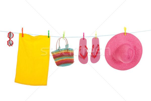 Praia lavanderia toalha óculos de sol linha enforcamento Foto stock © ivonnewierink