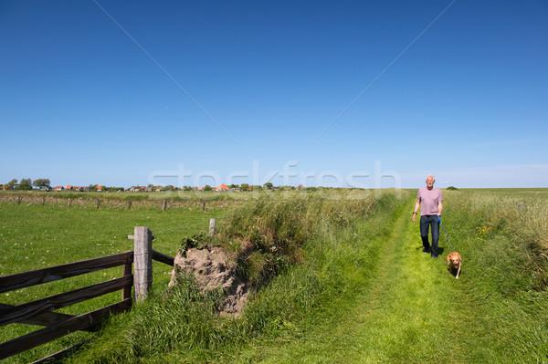 Walking with dog on Dutch Texel Stock photo © ivonnewierink
