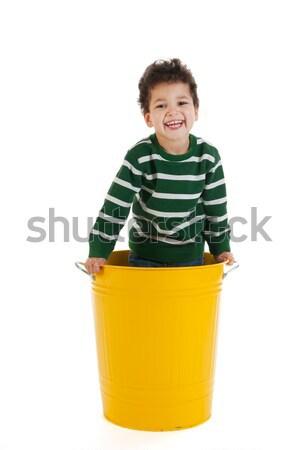 мало мальчика мусорное ведро черный вьющиеся волосы желтый Сток-фото © ivonnewierink