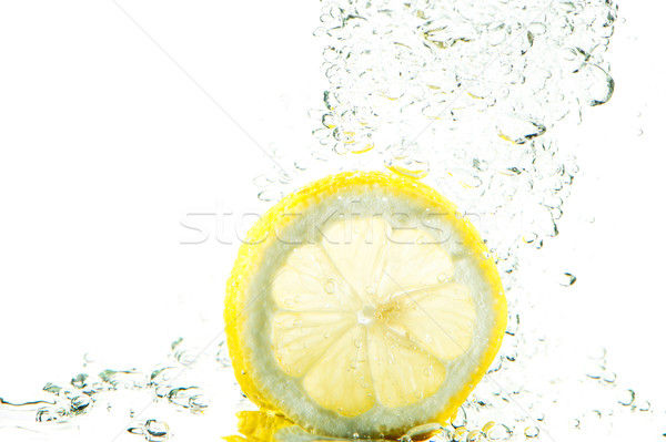 Fresh lemon splash Stock photo © ivonnewierink