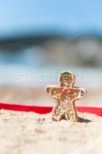Christmas ginger bread man at beach Stock photo © ivonnewierink