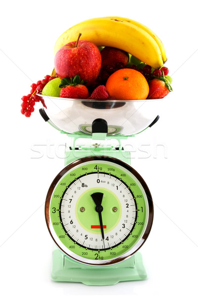 Kitchen scale with diversity of fruit Stock photo © ivonnewierink