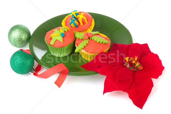 Christmas cupcakes balls and poinsettia Stock photo © ivonnewierink