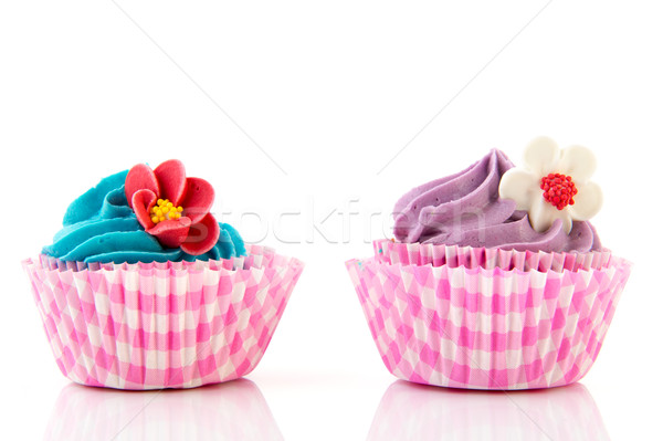 Lila rózsaszín minitorták kék vajkrém virágok Stock fotó © ivonnewierink