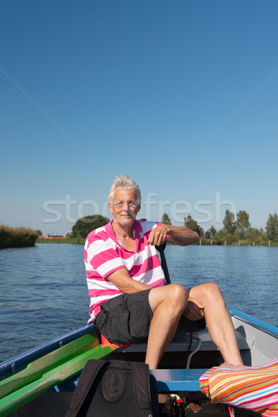 man in boat at the river Stock photo © ivonnewierink
