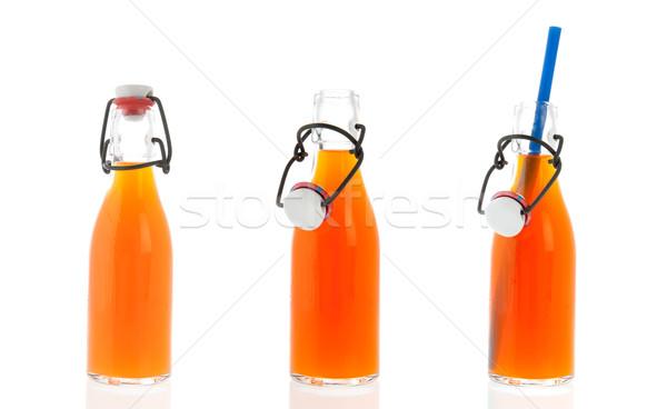 Rij flessen glas oranje frisdrank Stockfoto © ivonnewierink