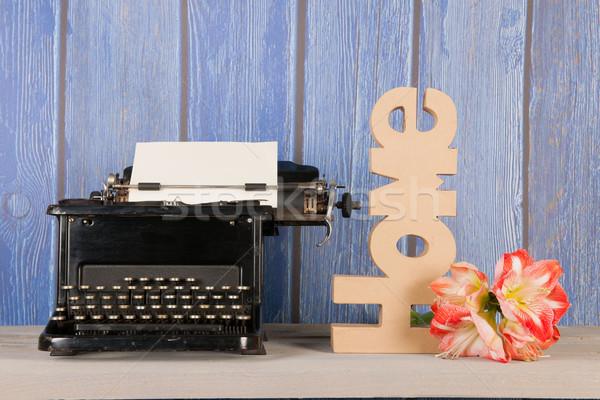 Antique typewriter with flower Stock photo © ivonnewierink
