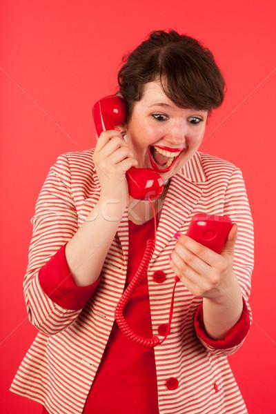 ストックフォト: 良いニュース · スマートフォン · 若い女性 · イヤホン · ビジネス · 女性