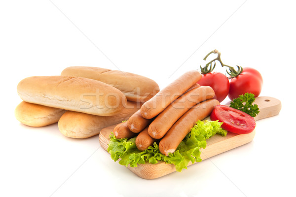 Sausages and bread rolls for hot dogs Stock photo © ivonnewierink