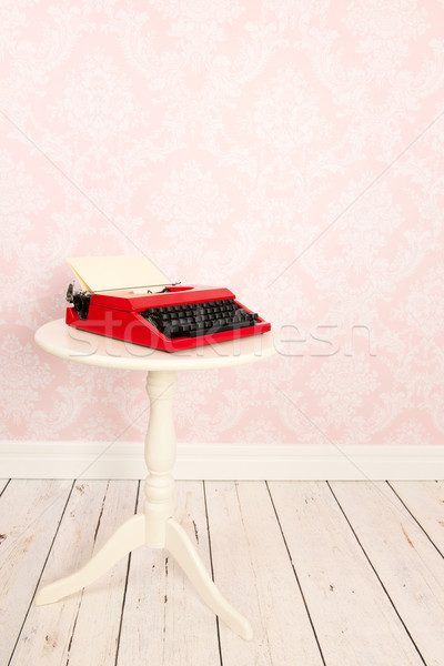 Vintage wall and wooden floor with old typewriter Stock photo © ivonnewierink
