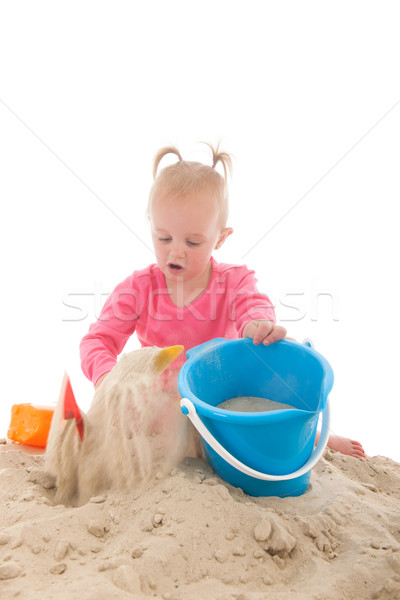 Little toddler playing in the sand Stock photo © ivonnewierink