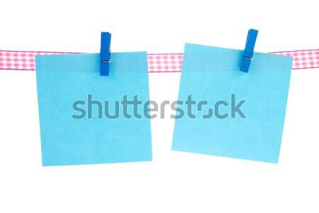 Niebieski notatka wiszący pusty własny tekst Zdjęcia stock © ivonnewierink