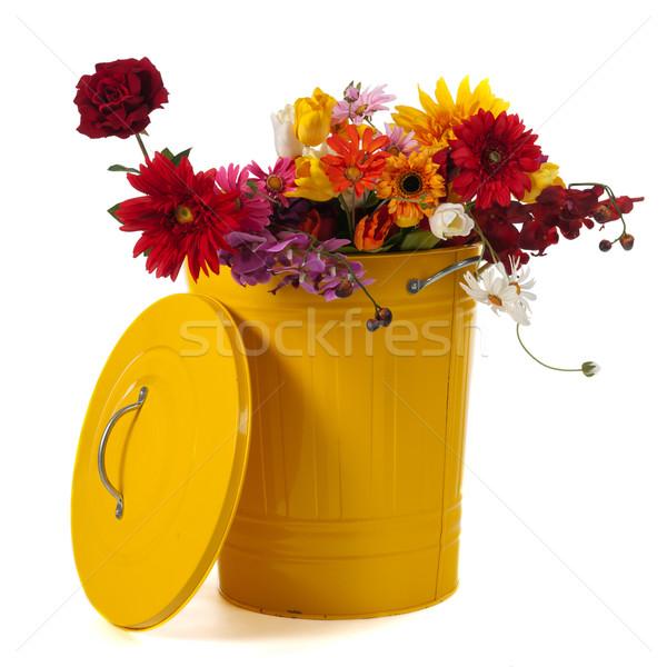Jaune poubelle fleurs isolé blanche Photo stock © ivonnewierink