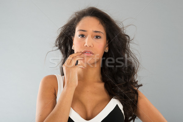 Attractive young woman portrait on gray background Stock photo © ivonnewierink