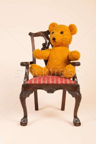 Stock photo: Bear sitting in chair