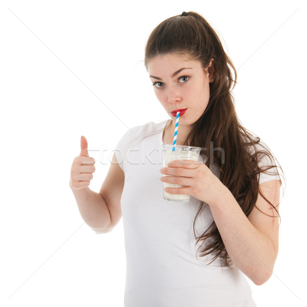 Stock photo: Young woman drinking milk