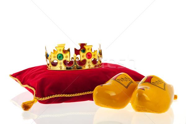 Golden crown on velvet pillow with Dutch wooden clogs Stock photo © ivonnewierink