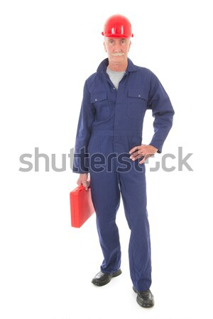 man in blue overall with red suitcase Stock photo © ivonnewierink