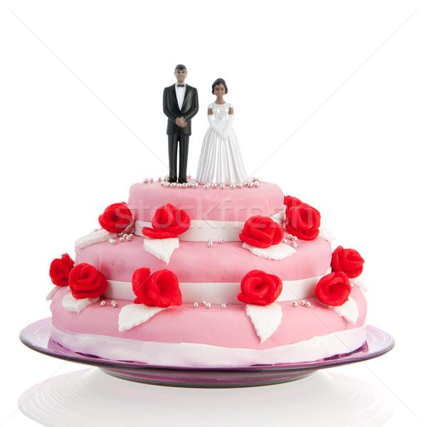 Fekete pár felső esküvői torta rózsaszín vörös rózsák Stock fotó © ivonnewierink