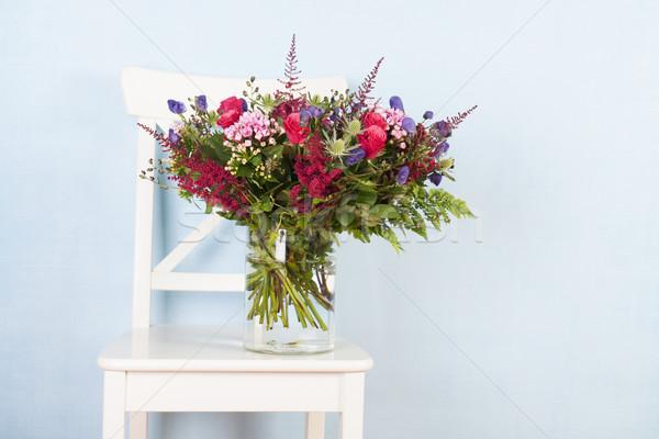 Mixed bouquet flowers on chair Stock photo © ivonnewierink