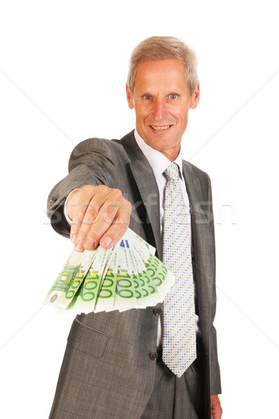 Senior business man with lots of money Stock photo © ivonnewierink
