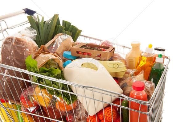 Корзина полный молочная продуктовых продукции изолированный Сток-фото © ivonnewierink