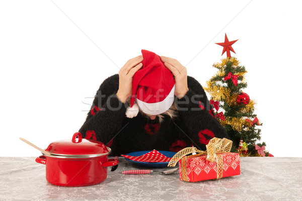 Woman of mature age alone with Christmas Stock photo © ivonnewierink