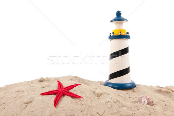 Farol praia miniatura branco azul vermelho Foto stock © ivonnewierink