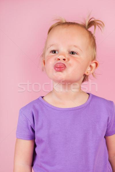 Méchant petite fille portrait fille rose Photo stock © ivonnewierink