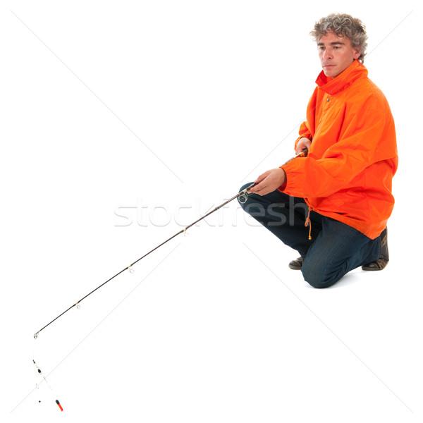 Fisherman with fishing rod Stock photo © ivonnewierink