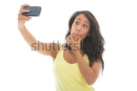 Black woman taking mad selfie Stock photo © ivonnewierink