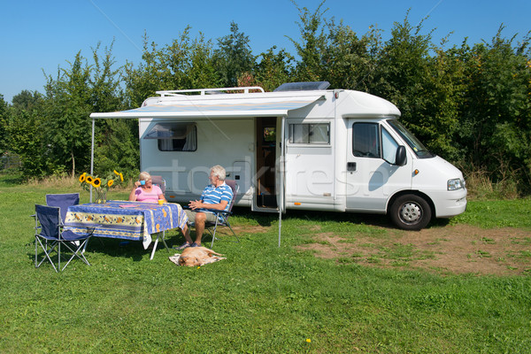 Couple with mobil home Stock photo © ivonnewierink