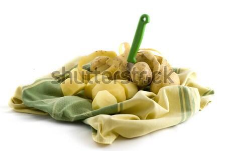 Peeling potatoes Stock photo © ivonnewierink