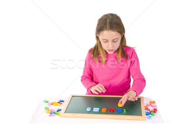 Oktatás számok kislány dolgozik oktatási cél Stock fotó © ivonnewierink