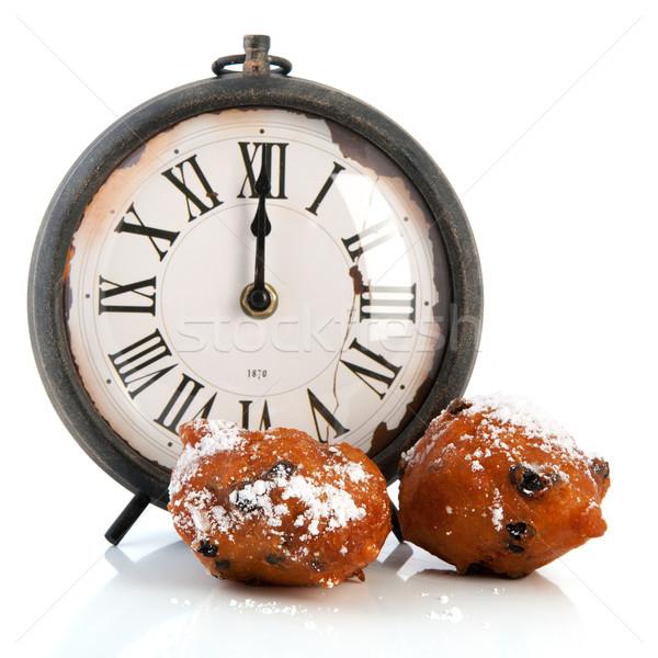 Dutch traditional oliebollen and clock Stock photo © ivonnewierink