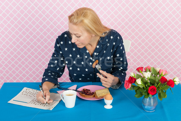 woman making crossword puzale in the morning Stock photo © ivonnewierink