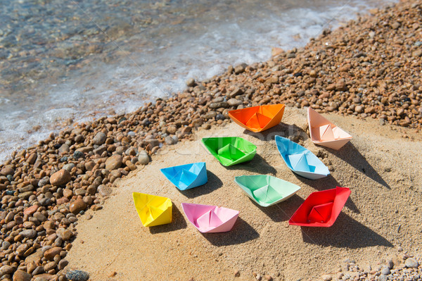 Paper boats at the beach Stock photo © ivonnewierink