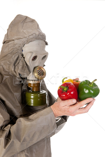 Stock photo: Man with gas mask and vegetables
